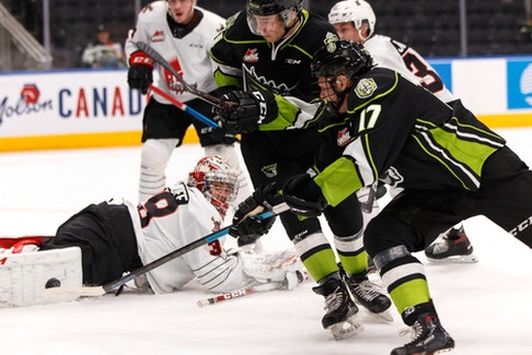 Edmonton Oil Kings' Carson Latimer (17) is stopped by Moose Jaw Warriors goaltender Adam Evanoff (39) at Rogers Place in Edmonton on Dec. 3, 2019.