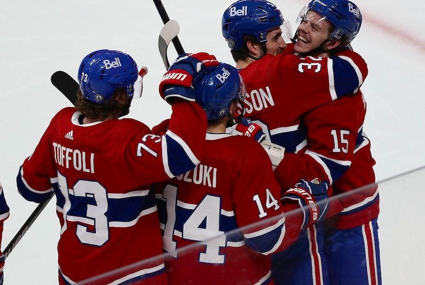 Montreal Canadiens' Jesperi Kotkaniemi (15) celebrates his game winning goal with teammates Tyler Toffoli, Nick Suzuki and Erik Gustafsson during overtime in Game 6 in Montreal on May 29, 2021.