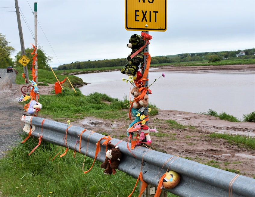Stuffed toys tied to a sign pole near the site of the former Residential School in Shubenacadie. - Richard MacKenzie