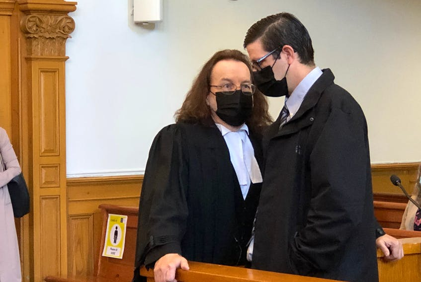 Defence lawyer Bob Buckingham speaks with his client Steve Bragg at Supreme Court of Newfoundland and Labrador in St. John's Monday morning.