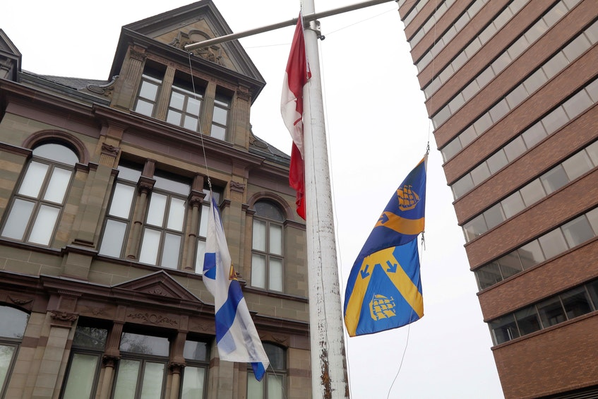 The flags at Halifax City Hall fly at half-mast to remember those 215 children found at a mass grave at a residential school in Kamloops, BC. - ERIC WYNNE/CHRONICLE HERALD