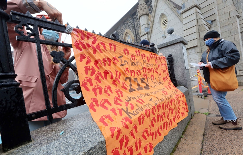 A small gathering was held outside St. Mary's Basilica on Spring Garden Road in Halifax to remember the lives of the 215 indigenous children who were found in a mass grave near a former residential school in Kamloops, BC. - ERIC WYNNE/CHRONICLE HERALD