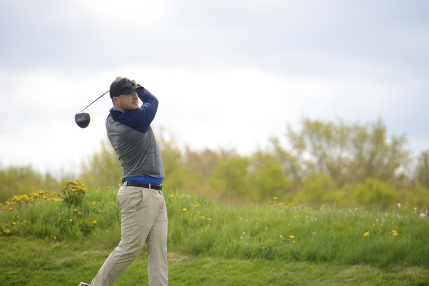 Brodie McGregor follows a tee shot during Round 1 of the Andersons Creek Open golf tournament in Stanley Bridge on Saturday. McGregor won the Men's Championship Division. - Jason Malloy