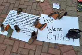 Signs were also placed near the Macdonald statue, some with the words of residential school survivors.