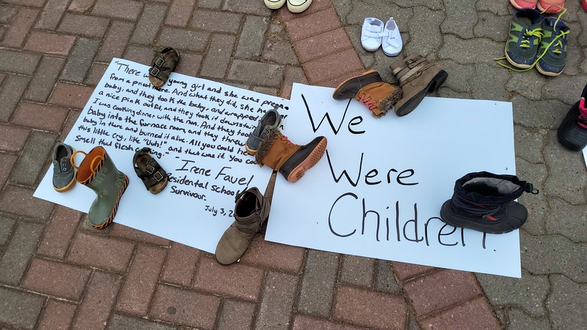 Signs were also placed near the Macdonald statue, some with the words of residential school survivors.  - Logan MacLean