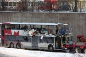 A file photo shows the OC Transpo bus involved in the crash at Westboro Station being towed from the scene.