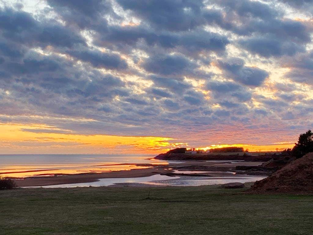 The sun was setting when Ian Wallis snapped this lovely photo at the golden hour of the day in Argyle Shore PEI. Nothing beats a good sunset, the colours, the clouds and the ambiance…thank you for the photo Ian.
