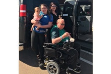 Taylor Pound, left, holding a baby cousin, stands with her mom, Betty Pound, and her father, Allan Pound, seated in his wheelchair, at Marco Polo Land in August 2017. The Pounds passed on the van when Allan died and it continues to be donated to new owners.