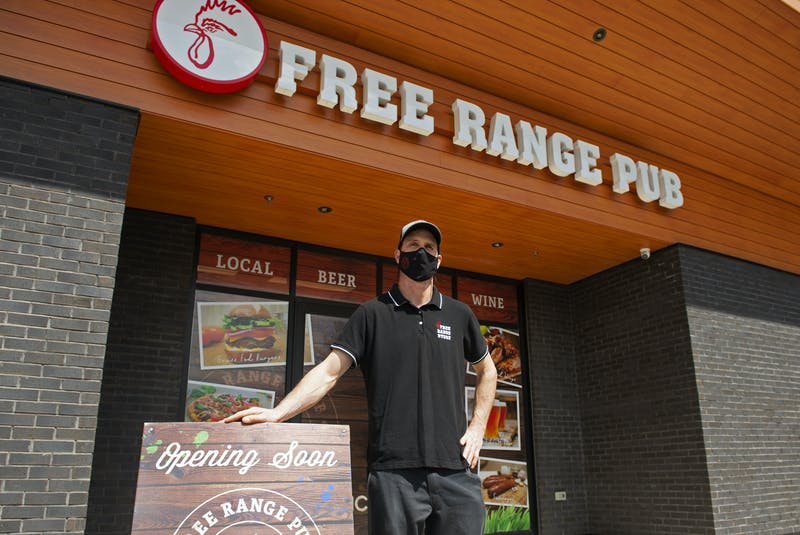 Cam Taylor, owner of the Free Range Store on Larry Uteck Boulevard, poses for a photo outside his new pub on Tuesday, May 5, 2021. The Free Range Pub in the Kearney Lake Plaza is scheduled to open for food takeout and delivery next week. - Ryan Taplin