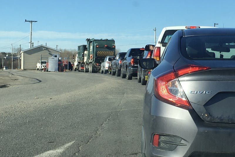 Vehicles wait to enter the Sydney Port Access Road waste management facility on Tuesday. IAN NATHANSON/CAPE BRETON POST - Ian Nathanson
