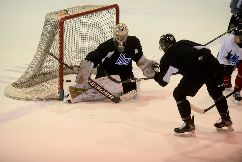 Goalie Colten Ellis prepares to make a blocker save on Brendan McCarthy during Tuesday's Charlottetown Islanders practice at the Eastlink Centre.