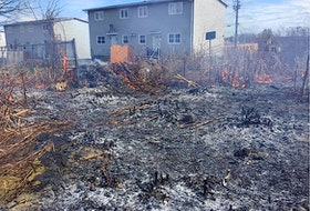 Members of the Westmount Volunteer Fire Department fighting a grass fire near homes in the community on April 29. The fire department is issuing a plea to the public to report grass fires. Fire chiefs in the Cape Breton Regional Municipality say this is the only place across the country known to have an actual grass-fire season. CONTRIBUTED
