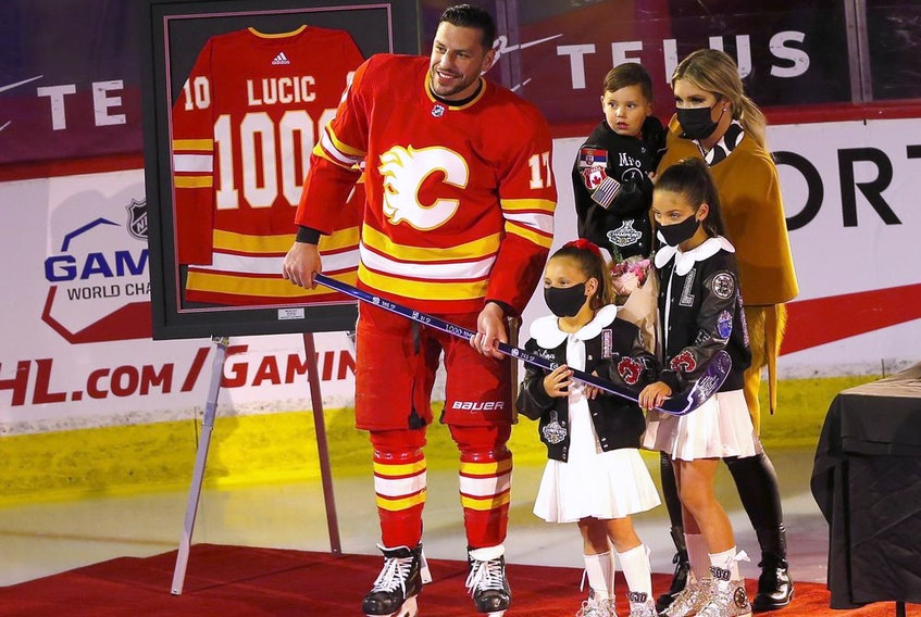 Calgary Flames forward Milan Lucic is honoured for reaching 1,000 NHL games played before taking on the Ottawa Senators at the Scotiabank Saddledome in Calgary on Monday, April 19, 2021.