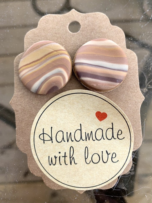 Holly Fraser's 'handmade with love' earrings sell for $10. - Carole Morris-Underhill