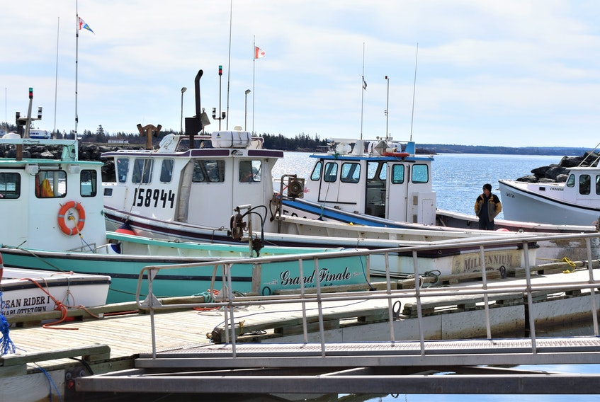 There wasn't a lot of activity at the Cape John Wharf a day before setting day, originally scheduled for April 30, but a few lobster fishermen were around, including Keith Heighton on his boat Risky Business.