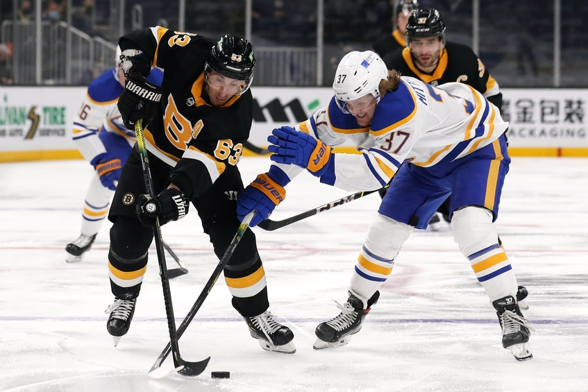 Boston Bruins winger Brad Marchand (63) tries to get past Buffalo Sabres centre Casey Mittelstadt (37) during Thursday's NHL game at Boston's TD Garden. - - Winslow Townson-USA TODAY Sports