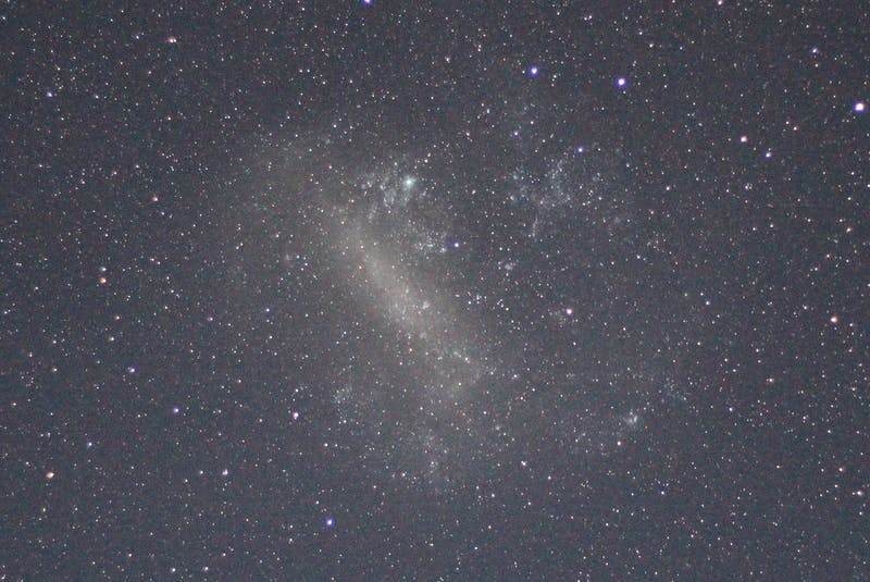 "The small (shown) and large Magellanic Clouds are galaxies just outside the Milky Way that appear as a ""smudges"" of light in the night sky of Earth's southern hemisphere. - Contributed"