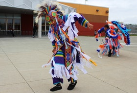Liddell Sylliboy and Karzen Toney, both of Eskasoni First Nation, dance outside Maupeltuewey Kina'matno'kuom, the school in Membertou First Nation in 2019. The school is part of the Mi'kmaw Kina'matnewey, the organization that oversees Mi'kmaq education in Nova Scotia and a recipient of this year's Governor General's Innovation Award. FILE