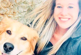 Amber Barrett with her dog Molly, one of her beloved pets. She also has two horses, Maggie and Grace. CONTRIBUTED