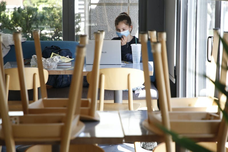 Vivienne Vassallo, takes part in online schooling at a table in an empty Mappatura Bistro, co-owned by her parents, in Halifax on Tuesday, May 4, 2021. The restaurant, still open for takeout, is closed to dining in, like so many others in the province due to COVID-19 restrictions. - Tim Krochak