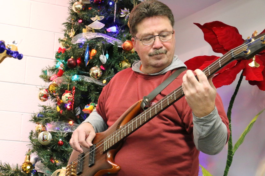 Chuck Porter loves performing and has been involved with countless fundraisers over the years. He's pictured here in 2016 performing with the Fretnotes at the annual tree lighting and Santa visit in Vaughan. - Carole Morris-Underhill