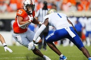 Running back Chuba Hubbard (30) of Oklahoma State. Brian Bahr, Getty Images, file