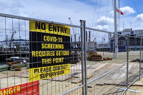 A sign warns of COVID-19 restrictions on the Halifax waterfront in May 2021.