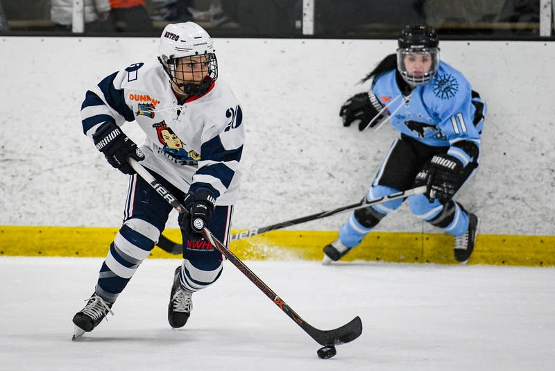 Mallory Rushton in action with the NWHL's Metropolitan Riveters. Rushton made history on April 24 when she served as an assistant coach with MHL's Amherst Ramblers. - Contributed