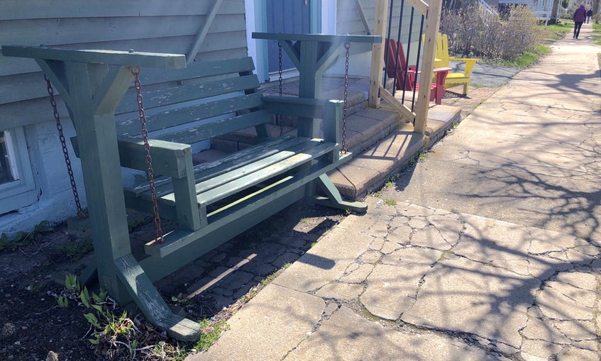 This swinging bench outside Greg MacLeod House used to have a welcome to use sign beside it and was a favourite place for many cruise ship visitors to sit and enjoy the sunsets over Sydney harbour. NICOLE SULLIVAN/CAPE BRETON POST  - Nicole Sullivan