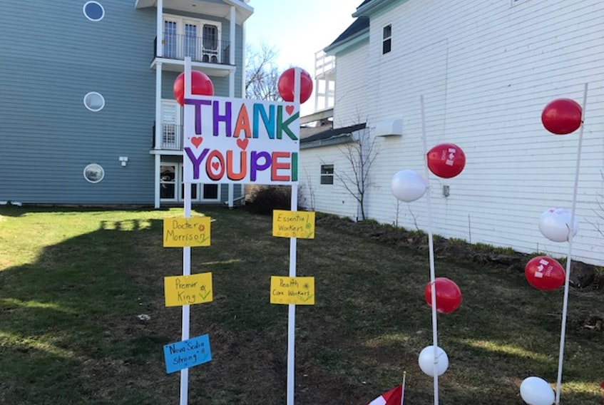 The owners of a 27-unit condo building in downtown Charlottetown, P.E.I. express their appreciation with a sign and sidewalk messages, thanking health-care workers, essential workers, Dr. Heather Morrison and Premier Dennis King. SaltWire File