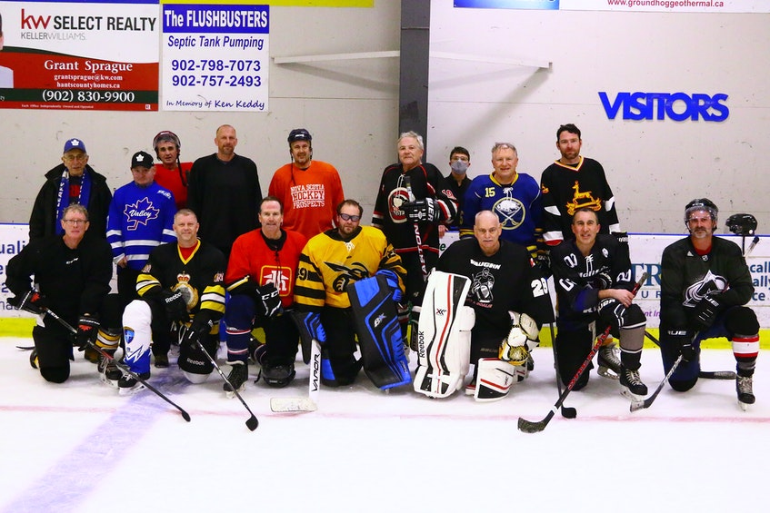 The Hants Exhibition Arena All-Stars (formerly the Windsor Warlords) alumni team consisted of, from left, back row: Coach Stan Kochanoff, trainer Chris Arnold, Chris Hebb, Bradley Burgess, Mike Peach, Paul Beazley, manager Craig Martin, Jeff Burgess and Chris Caines; front row: Bunker (David) Trinacty, Darren Burgess, Garth Redden, Ray Croft, Larry Warren, Jim Kochanoff and Michel Cochrane.  JIM IVEY  - Contributed