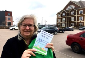 Former Green party candidate Darcie Lanthier holds a copy of the rental registry she launched in February. More than 500 Charlottetown residents have signed on to the registry so far.