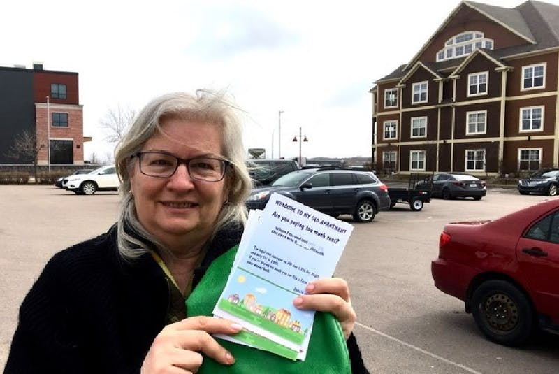 Former Green party candidate Darcie Lanthier holds a copy of the rental registry she launched in February. More than 500 Charlottetown residents have signed on to the registry so far.  - Rafe Wright/Special to The Guardian