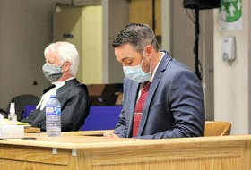 Royal Newfoundland Constabulary officer Doug Snelgrove (right) sits in the prisoner dock next to his lawyer, Randy Piercey, in Newfoundland and Labrador Supreme Court in St. John's Wednesday afternoon, awaiting the start of his sexual assault trial.