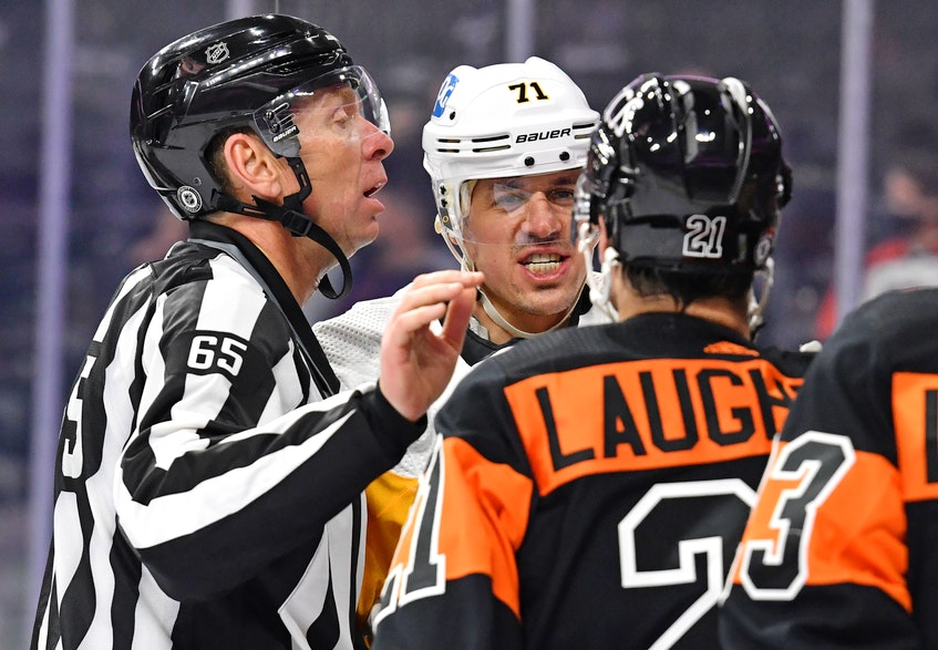 Pittsburgh Penguins centre Evgeni Malkin and Philadelphia Flyers winger Scott Laughton are separated by linesman Pierre Racicot during Monday's NHL game at the Wells Fargo Center in Philadelphia. - Eric  Hartline
