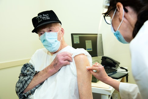 Thomas Mckinnon rolled up his sleeve Tuesday, March 9, to receive his COVID-19 vaccine. He is one of the first Nova Scotians to receive his COVID-19 vaccine through a pharmacy clinic. - Communications Nova Scotia