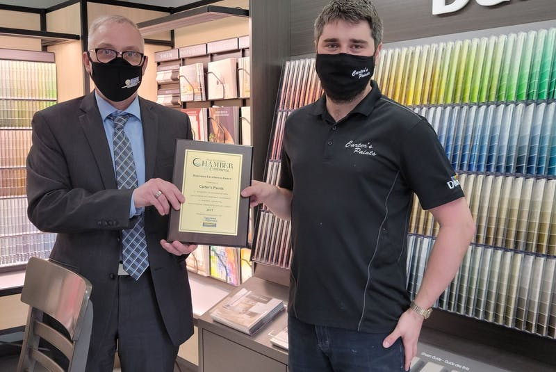 George Oberprieler, left, CEO of Community Credit Union Truro, presents Jeremy Carter, of Carter's (Truro) Limited Paints with the 2021 Business Excellence Award. - Contributed