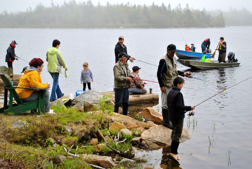 People dot the shoreline at Alvin Lake while others head out in boats for the Shelburne County Fish and Game Association's annual fishing derby in 2018. While COVID has put a halt to the annual derby, the SCFGA has a vision for an accessible manmade trout fishing pond, perhaps somewhere in the Clyde River area. KATHY JOHNSON