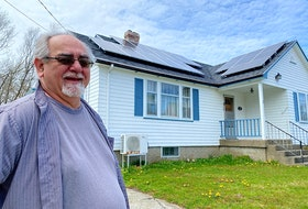 Don Deveau stands in front of his home in Yarmouth, which features 14 solar panels. CARLA ALLEN • TRICOUNTY VANGUARD