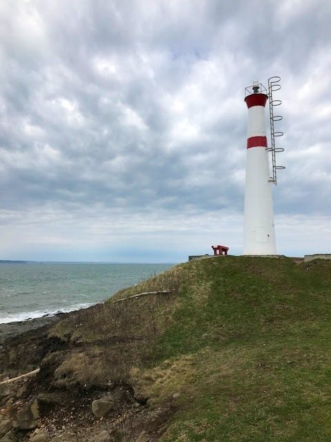 On the shore of the Bay of Fundy, in a small community called Canada Creek, you'll find the Black Rock Lighthouse. Michele Cooper was there on an overcast day and took this dramatic photo of the ominous spring clouds mimicking the churning waved below.   Thank you for the photo Michele.