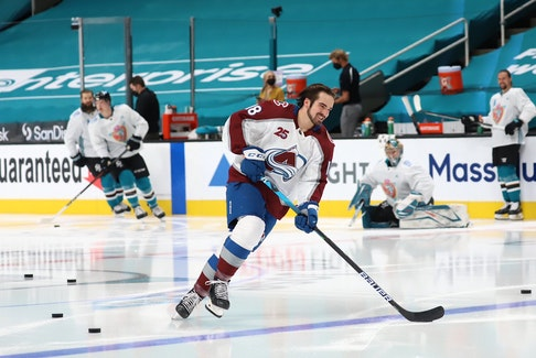 In an NHL tradition, his Colorado Avalanche teammates saw to it that Alex Newhook had a few solo turns during the first part of the warm-up skate prior to the Avalanche's Wednesday-night game against the Sharks in San Jose. Newhook enjoyed the moment, as did onlooking Sharks; players, including defenseman Erik Karlsson (right). — Colorado Avalanche/Twitter