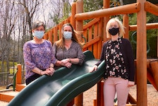 Berwick and District Nursery School director and teacher Cindy Gates-Dee, assistant director and teacher Christa Reid and Joanna McGrath, co-president of the parent executive, by the play structure that parent volunteers fundraised to pay for – and volunteers from the military helped install. KIRK STARRATT