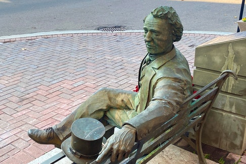 This statue of Sir John A. Macdonald sits on a bench at the corner of Queen and Richmond streets at the entrance to Victoria Row in Charlottetown. SaltWire file