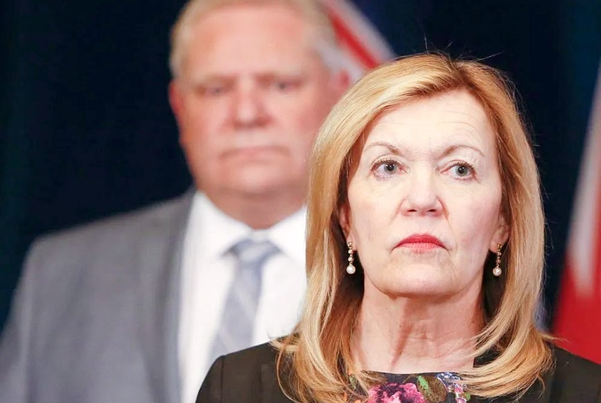 """Health Minister Christine Elliott, with Premier Doug Ford behind her, said on Wednesday that Ontario would not be allowing organized sports """"based on the medical advice that we've received from the experts."""" POSTMEDIA FILES"""