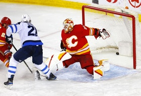 Calgary Flames goalie Jacob Markstrom is scored on by the Winnipeg Jets' Paul Stastny at the Scotiabank Saddledome in Calgary on Wednesday, May 5, 2021.