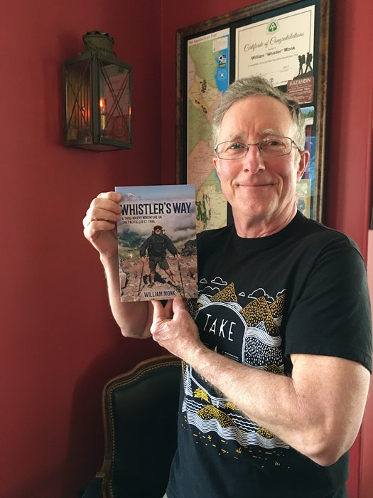 Granville Ferry author William Monk holds a copy of his new book, Whistler's Way: A Thru-Hikers Adventure on The Pacific Crest Trail. - Contributed