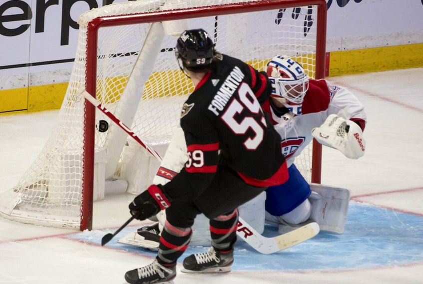 Senators' Alex Formenton beats Canadiens goalie Jake Allen in the third period at the Canadian Tire Centre in Ottawa on Wednesday night.