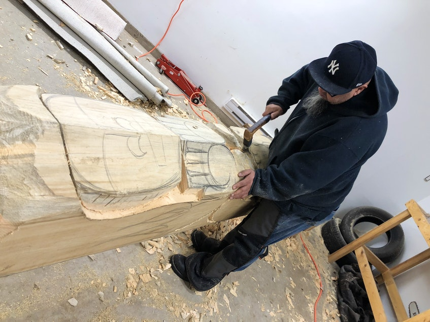 Gerry Sheena in his workshop at Friends United carving his project