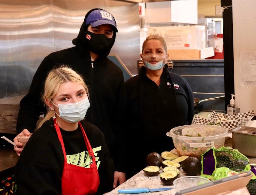 From left are Karina Stelmashchuk, Alex Frangos and Claudia Perez. Frangos owns and manages El Sabor de Mexico while Perez (Frangos' mother) and Stelmashchuk cook.  - Logan MacLean
