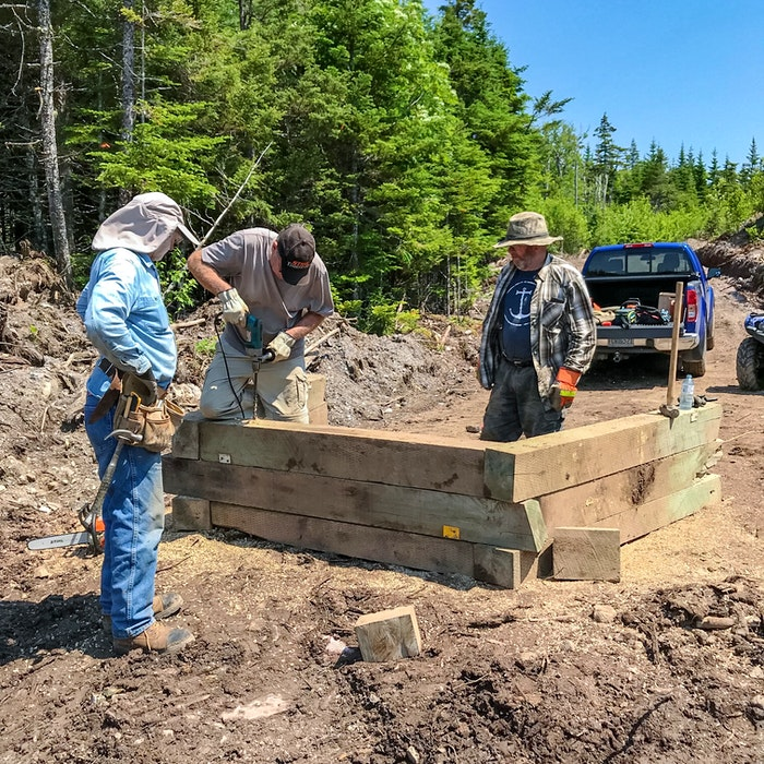 Workers construct Beth's Road Bridge, so that ATVers can cross a small stream along the Beth's Road system. CONTRIBUTED